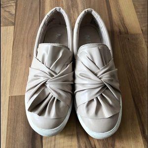 Adorable pair of cream colored Mia slip ons.